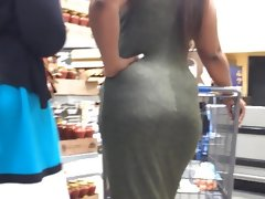 Candid ebony curves in olive dress..