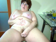 Fat nanny is satisfying herself in the..