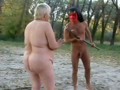 Fat granny is sucking a dick outdoors