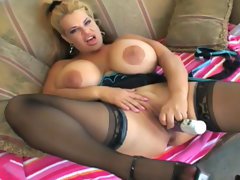 Busty blonde in stockings is fingering..