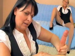 Two matures are masturbating a cock