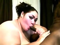 Large slut sucking some black cock